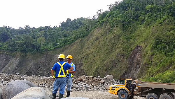 ICE workers on site at the Reventazon Dam in Costa Rica